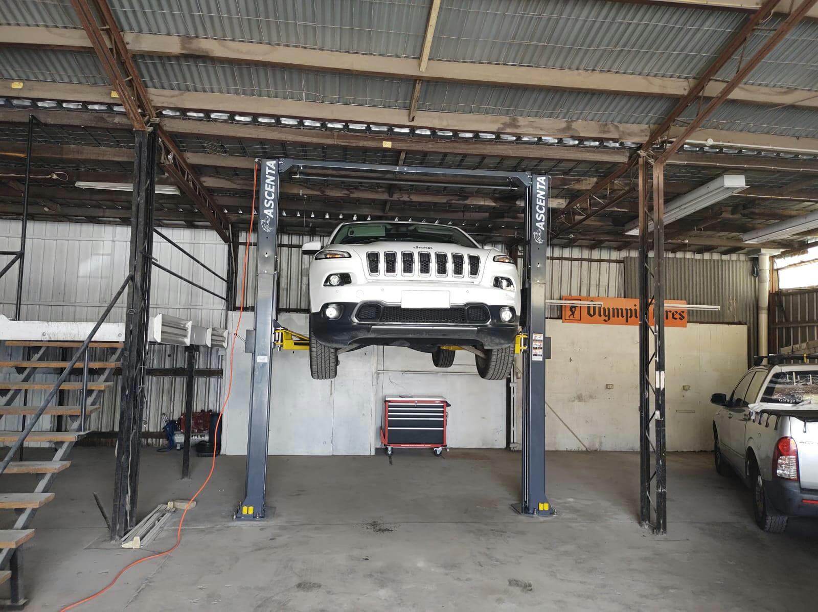 Jeep on a 4 tonne, 2 post clearfloor hoist.